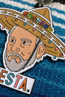 Serious-Faced Coach Pop Wears Sombrero in Hilarious Fiesta Medal