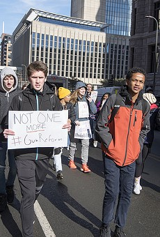 Students march in Minneapolis on February 21 to protest lax gun laws.