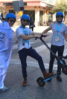 SXSW attendees try out San Antonio startup company Blue Duck Scooters' rentable rides.