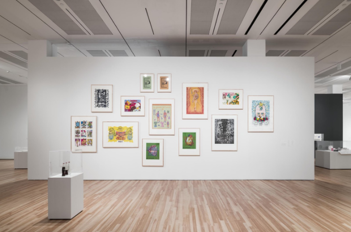 An important thread in the exhibition is the use of words in art for protest. This wall features prints by Chicanx printmakers that comment on the labor movement, borders, and loss.