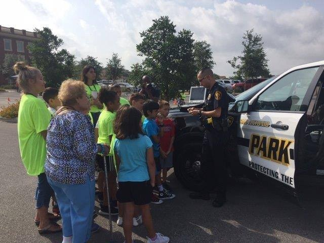 A park police officer shows off his patrol vehicle to visitors. - FACEBOOK / SAN ANTONIO PARK POLICE