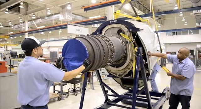 Standard Aero employees at Port San Antonio work on an engine. - COURTESY PHOTO / PORT SAN ANTONIO