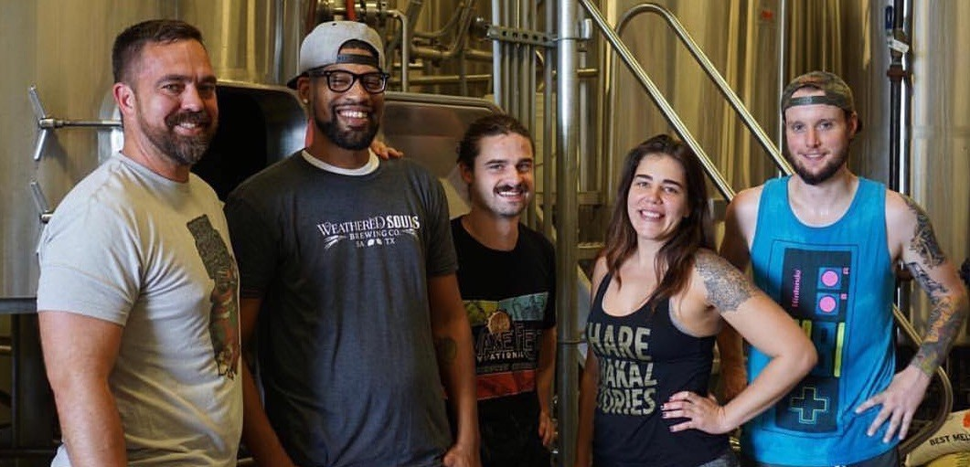 Weathered Souls founder Marcus Baskerville (second from left) visits a Miami craft brewery in 2018 — the site of another of his collaborations. - INSTAGRAM / @WEATHEREDSOULSBREWING_MARCUS