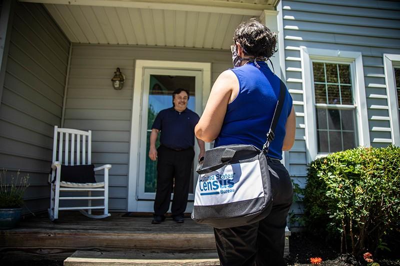 A census taker maintains social distance as she visits a home. - COURTESY PHOTO / U.S. CENSUS BUREAU