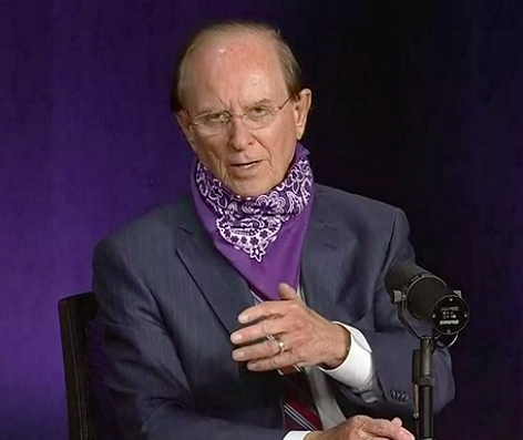 County Judge speaks during a recent press briefing with a bandana around his neck. - SCREEN CAPTURE / KSAT