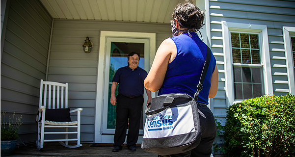 A census taker maintains social distance as she visits a home. - COURTESY PHOTO / U.S. CENSUS BUREAU
