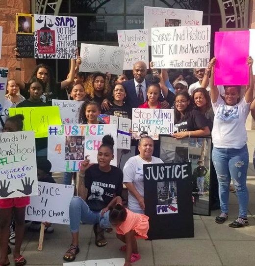 """Family members of Charles """"Chop"""" Roundtree Jr.proest in front of the Bexar County Courthouse. - INSTAGRAM / ATTY_DARYL_WASHINGTON"""