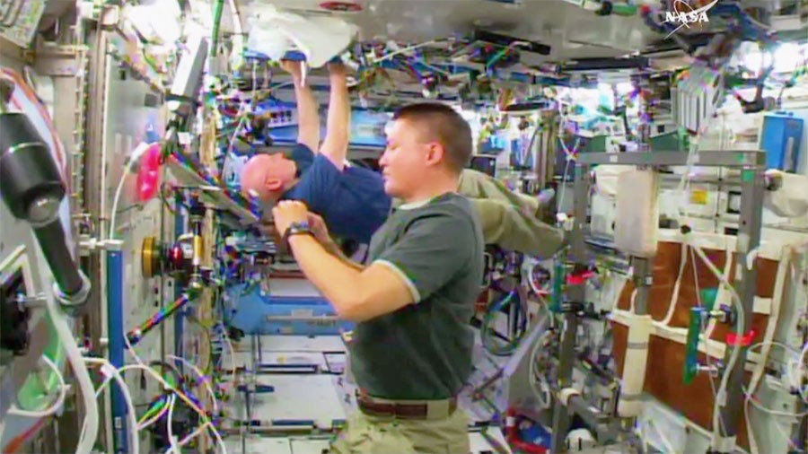 NASA Astronauts Scott Kelly and Kjell Lindgren doing space stuff, no big deal. - NASA TV