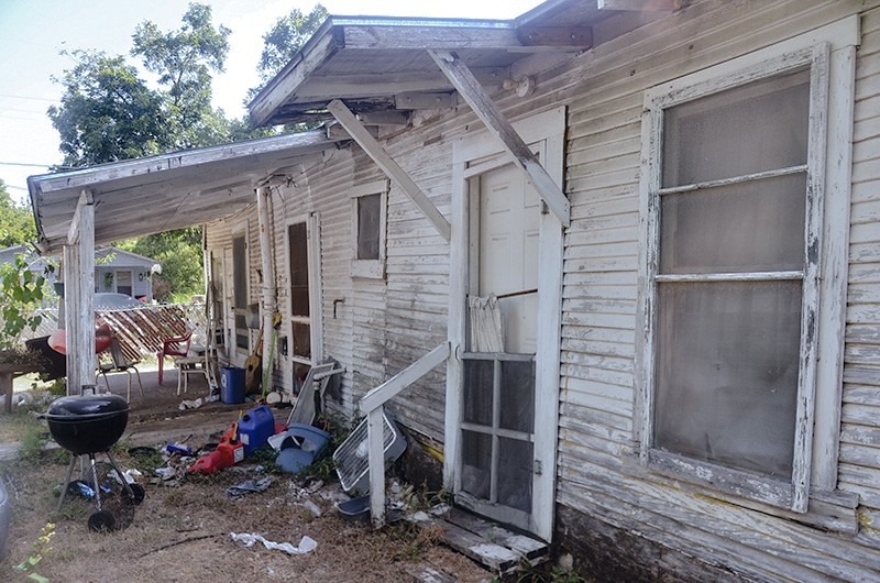 Margaret Crain and son Robert share this home, which could use some fixing. - MICHAEL MARKS