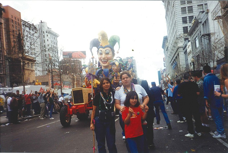 Itza Carbajal with her family during New Orleans' famous Mardi Gras celebration. Carbajal was evacuated to San Antonio, which she now happily calls home. She works at the Esperanza Peace & Justice Center. - COURTESY OF ITZA CARBAJAL