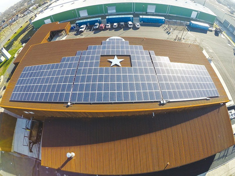 Solar panels lined up on the roof of Alamo Brewing Company. - COURTESY