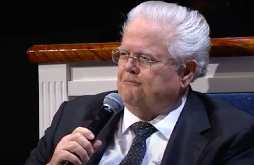 A seated John Hagee tells his flock Jesus healed him of double pneumonia. - YOUTUBE CAPTURE / FRIENDLY ATHIEST