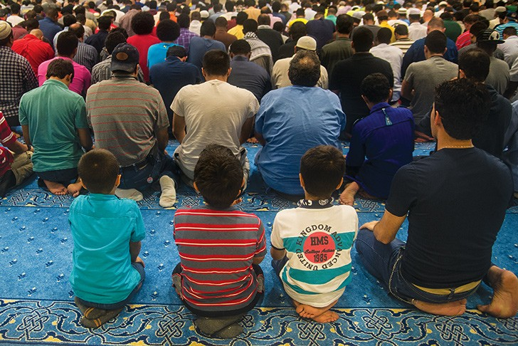 Muslim men and boys during Friday night prayers at a local mosque last year.