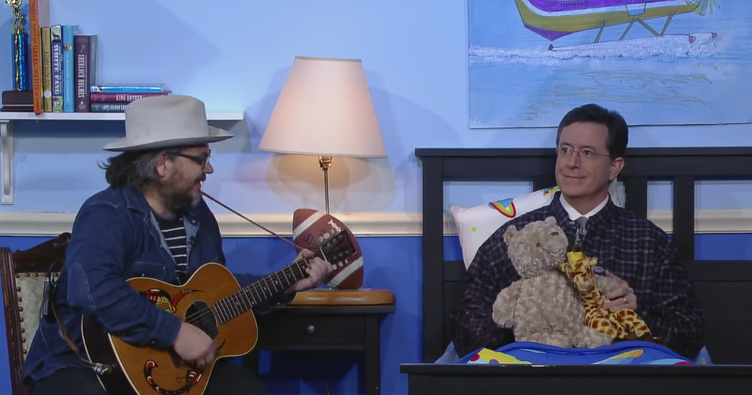 Tweedy tucking in lil' Stevie, which is, coincidentally, also Colbert's hip-hop moniker - YOUTUBE