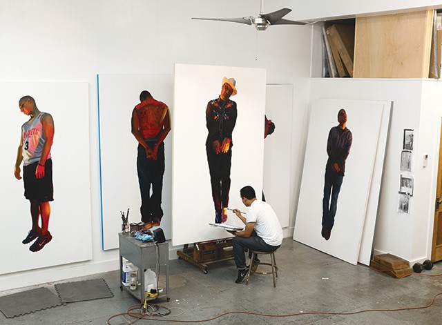 Vincent Valdez in the studio, working on 'The Strangest Fruit', 2013, which explores the history of lynchings of Mexicans in the Southwest. - COURTESY OF THE ARTIST