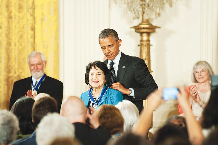 President Barack Obama awards Dolores Huerta in 2012 with a Medal of Freedom.