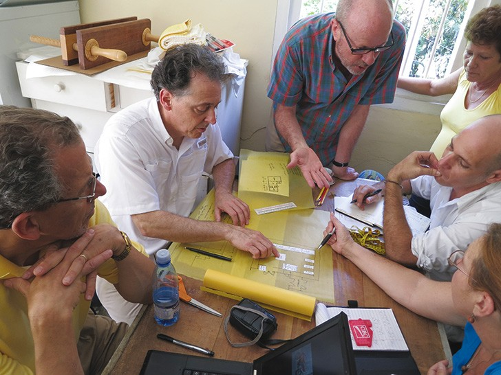 Cuban and American colleagues work on the design for a new archival facility in Hemingway's basement in 2012.