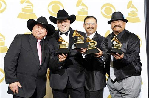 Farias (left) with his Grammy and Los Texmaniacs. - FACEBOOK