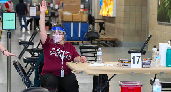 A worker at San Antonio's Alamodome vaccination site calls for the next person to receive a shot. - COURTESY PHOTO / CITY OF SAN ANTONIO