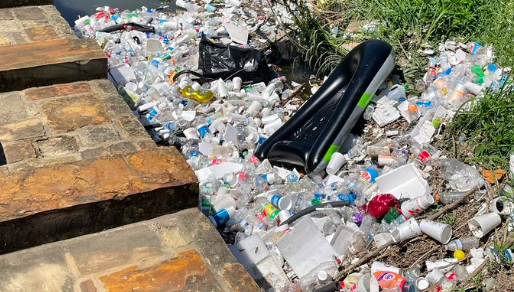This photo shared on Twitter shows litter washed up along the banks of the San Antonio river near Confluence Park. - TWITTER / @RYAN_SERPICO