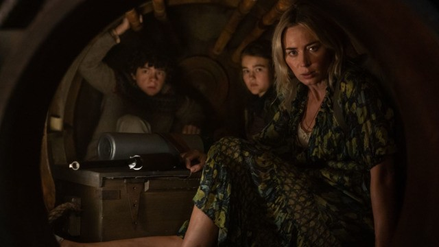 """Evelyn (Emily Blunt, far right) and her children, from left, Marcus and Regan, hide inside a furnace to avoid alien attackers in """"A Quiet Place Part II"""" - PARAMOUNT PICTURES"""