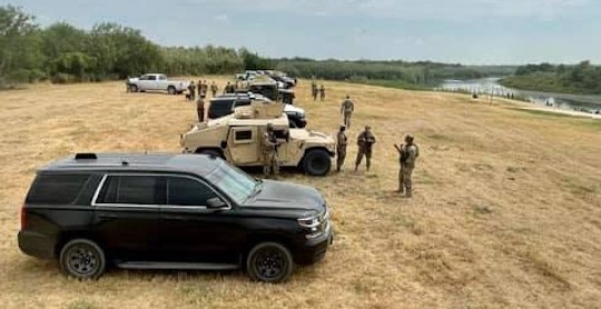 """Gov. Greg Abbott touted a cordon of DPS and military vehicles parked along a portion of the Texas border as a """"steel wall."""" - FACEBOOK / GREG ABBOTT"""