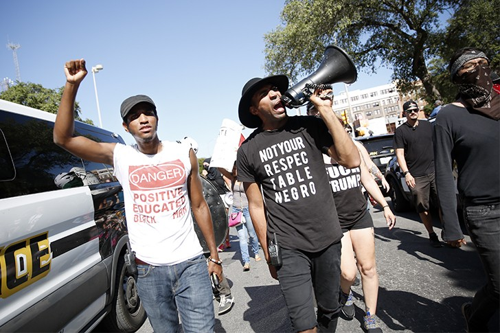 "Jonathan-David Jones and Mike Lowe lead the counter-protest to a ""Save the Monument"" rally on August 12. - TOMAS GONZALEZ"