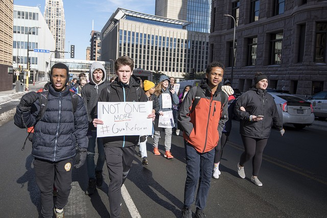 Students march in Minneapolis on February 21 to protest lax gun laws. - FLICKR CREATIVE COMMONS VIA FIBONACCI BLUE