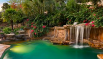 The waterfall-fed pool of this $1.9 million San Antonio mansion looks like a tropical lagoon