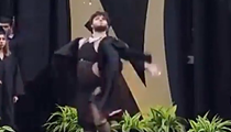 San Antonio high school graduation walk goes viral after student shows off revealing dress under robe