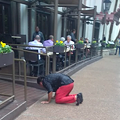Photos Capture Man Crawling out of San Antonio River and Prostrating Himself in Front of River Walk Diners