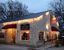 751d28f8_carriage_house_all_lit_up_outside_shot.jpg