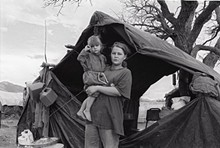 6bd0dc12_young_woman_with_child_border_camp_arizona-sonora.jpg