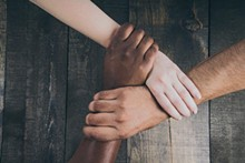 1fa9c7d3_team-hands-linked-together_925x.jpg