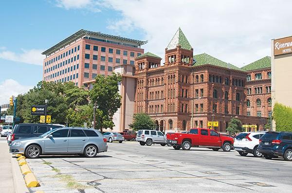 "View from Nueva Street: Let's rename surface parking lots ""zero-density development"" - CALLIE ENLOW"