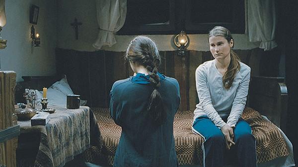 Voichita (Cosmina Stratan) looks at Alina (Cristina Flutur), the love that slips away in Beyond the Hills - COURTESY PHOTO