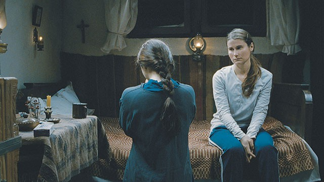 Voichita (Cosmina Stratan) looks at Alina (Cristina Flutur), the love that slips away in Beyond the Hills - COURTESY PHOTO