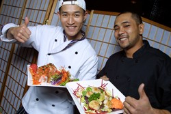Wasabi owner Isaac Yang and chef Jimmy Kim give their sushi a thumbs up.