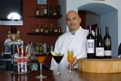 West Avenue Kitchen owner and chef Rick Frame sets up cocktails at his restaurant's full bar.