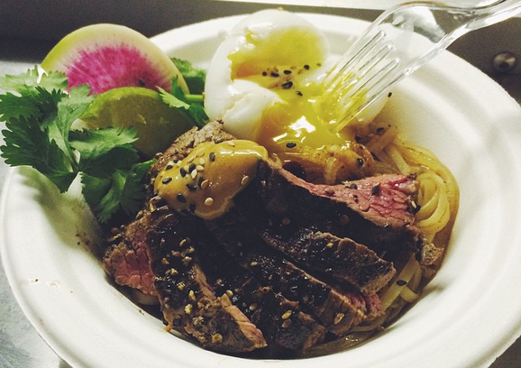 The egg yolk runneth over these tasty noodles from LocaVore food truck. - JESS ELIZARRARAS