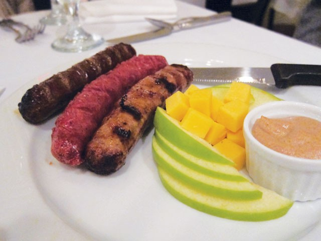 Wild game sampler (buffalo, venison, and wild boar sausages) served with spicy whole-grain mustard at Little Gretel. - HEATHER HERNANDEZ