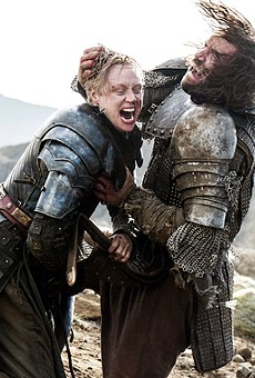 """Brienne of Tarth (Gwendoline Christie) and Sandor Clegane, """"The Hound"""", (Rory McCann) during their epic fight scene during the season 4 finale of HBO's Game of Thones."""