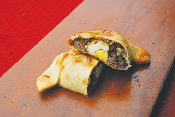 You'll be asking for a yapa from YAPA, especially the savory Conquistador empanada - MIRIAM SITZ