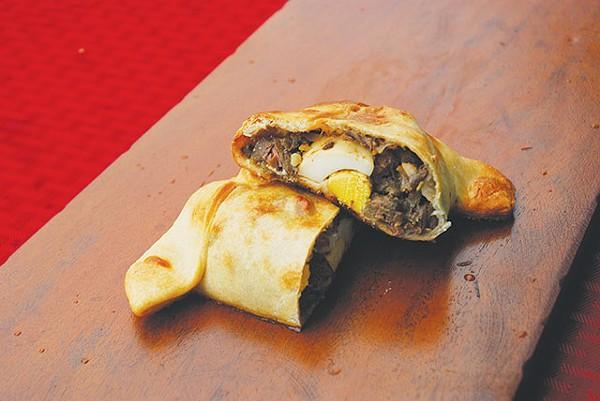 You'll be asking for a yapa from YAPA, especially the savory Conquistador empanada - MIRIAM SITZ