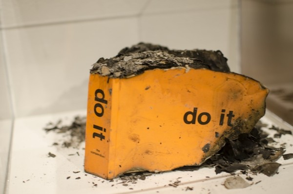 A burned instruction book from UMOCA's do it.