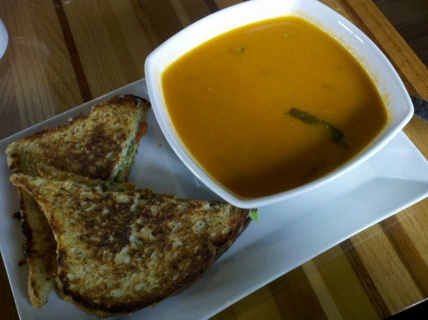A gooey grilled-cheese sandwich paired with tomato & basil soup.