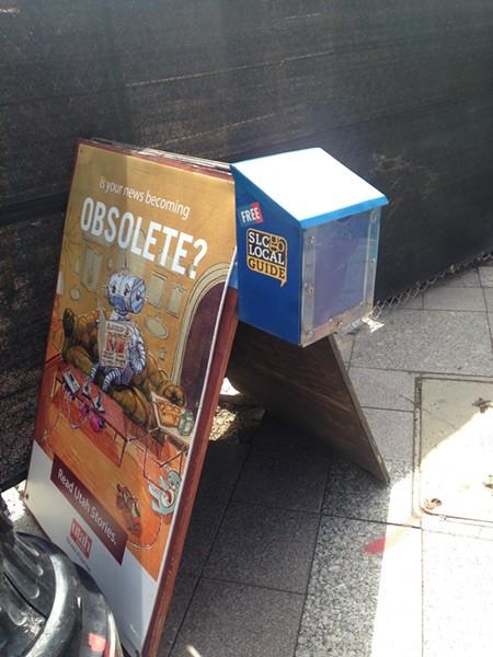 A news rack on 100 South and Main Street