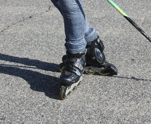 """A T-STOP IS EXACTLY WHAT IT SOUNDS LIKE. ONE FOOT IS PLACED BEHIND THE OTHER IN A """"T"""" POSITION, WITH THE WHEELS TILTED TOWARD THE HEEL OF THE OTHER SKATE. PRESSURE IS PUT ON THOSE WHEELS, AND THE DRAGGING MOTION WILL BRING YOU TO A STOP. THE HARDER THE PRESSURE, THE QUICKER THE STOP. DON'T BE AFRAID TO PRESSURE DOWN HARD ON THE BACK SKATE. - JOHN SWENSON"""