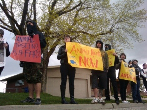 Activists picket 100 feet from the east bench home of a medical researcher on May 2. - JESSE FRUHWIRTH