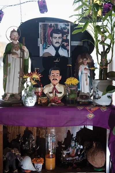 An altar for Jesús Malverde at Botanica San Antonio - NIKI CHAN